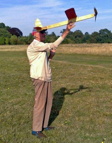 John Wassell with a free flight  		model